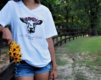 A THOUSAND HILLS vintage-style v-neck tee with black and berry cow graphic
