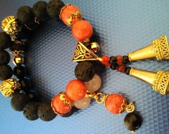 Bracelet of volcanic lava and Red jade with campaigns