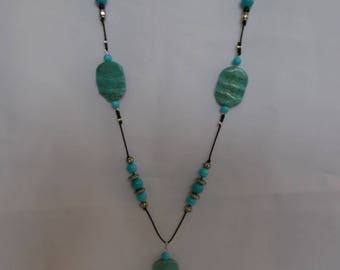 Necklace / turquoise and black / turquoise and glass beads.