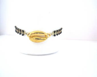 Shell gold chain black spike bracelet