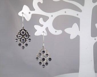 Black cats eye glass earrings