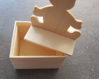 Very pretty little box in wood with Pooh on the lid for tooth