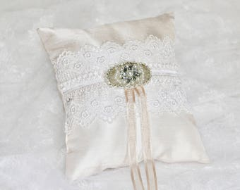 Wedding Ring pillow in light beige silk satin with white lace and a rhinestone embelishment