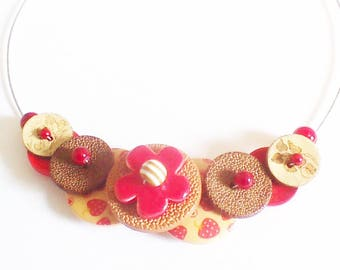 Necklace made with buttons, and red flower ceramic