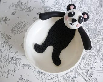 White jewelry dish with yellow dots with a panda