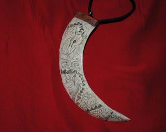 Boar tusk necklace, dragon scrimshaw