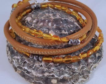 Beaded leather wrapping bracelet made of amber and Hämatitperlen, snap-in closure made of stainless steel