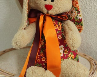 Plush red rabbit with flowers