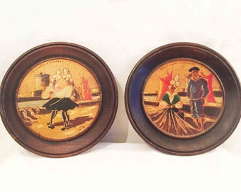 A beautiful pair of vintage French folk art wooden plates.