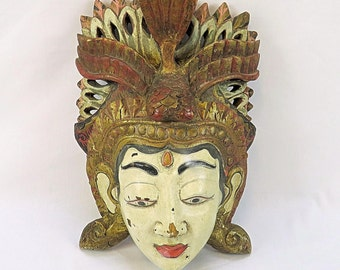 Old wooden mask from Indonesia used for rituals, with beauitful details