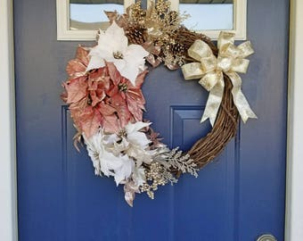 Luxurious winter poinsettia wreath. Christmas wreath with rose pink or blush and white flowers. Glitter accents, pinecones berries and bow!
