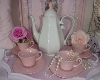 A coffee shabby chic, coffee pot and cups with saucers.