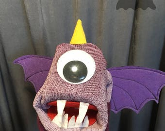 One eyed, one horned flying purple people eater - sock puppet - monster puppet - puppet toy - purple monster
