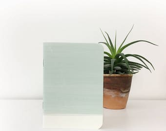 Green ombre A6 pocket notebook with water