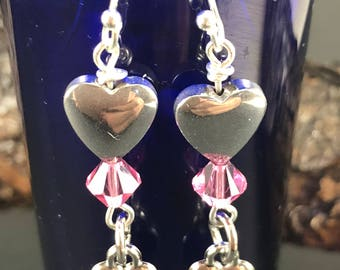 Double heart earrings with light pink stone