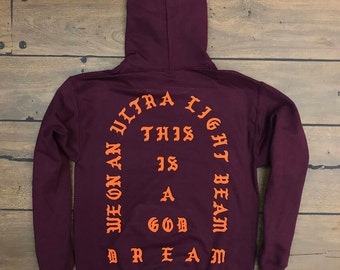 We On An Ultra Light Beam This A God Dream Hoodie (Orange Logo)