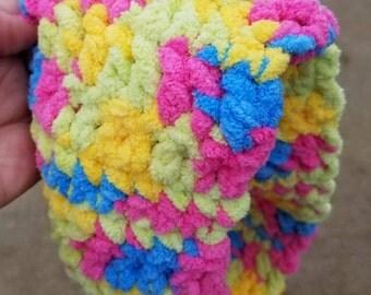 Multi colored crocheted ear warmer
