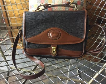 Dooney and Bourke Black and Brown all weather leather bag