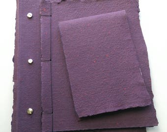 Large sketchbook with handmade raw purple and red flecked cover with screw posts