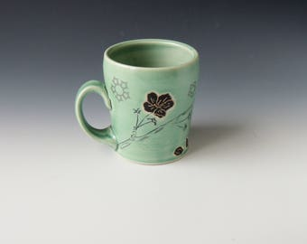 Ceramic Cherry Blossom Mug - green porcelain clay coffee cup with flowers and wifi decals - handmade wheel thrown pottery