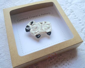 Ceramic Brooch, Black and White Sheep Mounted on Brass Colored Pin
