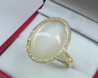 AAAA White Moonstone 18 x 13mm  9.02 Carats   14K Yellow gold Diamond halo cabochon ring. 1500