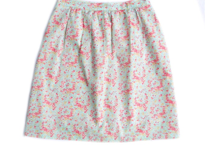 knee length, fully lined cotton skirt with elastic back waist band, liberty fabric pink flowers on turquoise background, vintage style skirt