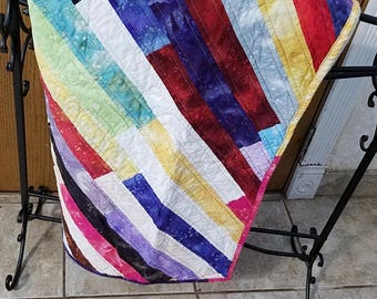 Bright  diagonal striped baby quilt 41 by 41 inches
