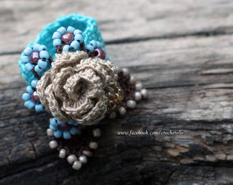 Cream rose crochet ring with blue flowers