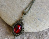 Bronze and red pendant
