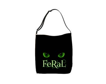 "green eyes ""feral"" typography text cat tote bag"