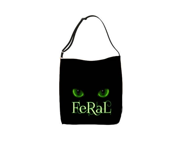 """green eyes """"feral"""" typography text cat tote bag"""