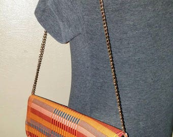 African Kente Cloth Clutch Handbag, Black Bag with Orange Multicolored Kente and Gold colored chain