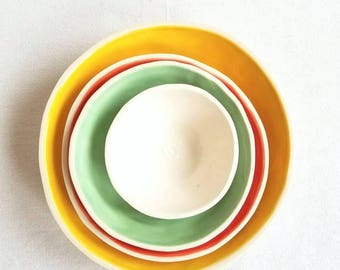 Ceramic nesting bowls in bright sunny colors. Hostess, housewarming, hors d'oeuvres! Small bowl set for condiments and dessert. Seattle made