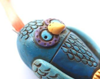 Blue owl folk art ornament with blue wings
