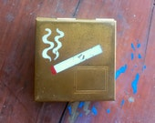 1930s brass portable ash tray w painted cigarette
