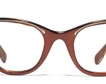 Vintage eyewear. Cat eye style! Made in USA by Tura 1950's. Luscious chocolate color Aluminum! Artistic detailing with rhinestones! Perfect