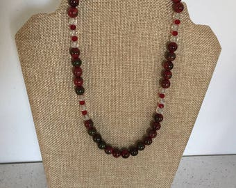 A Red and Clear Beaded Necklace.