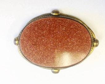 Antique Victorian large goldstone oval brooch. Antique sparkling Aventurine glass brooch in gilt brass.