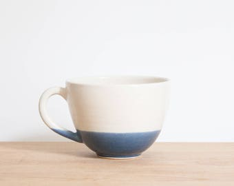 Blue Dipped White Ceramic Coffee Cup by Barombi Studios