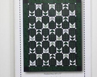 "Dad's Plaids:  flannel quilt pattern 61"" x 77""."