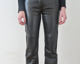Leather pants, vintage Redskins leather pants, vintage black leather pants, vintage leather pants, 90's leather pants,