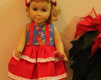 """Chatty Cathy Doll not included. Santa's Elf - 3 Pc Set.  Dress, Hat & Fake Candy Cane. Dress fits 20"""" dolls like the Chatty Cathy Dolls."""