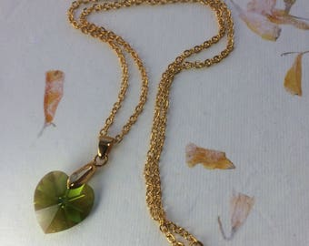 Gold plated pendant with large green sparkly Swarovski heart.