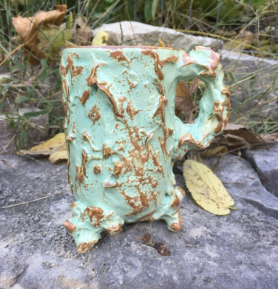 porcelain mug in pale green and rust brown