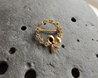 Circular Diamante Brooch with Bow Detail