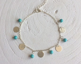 Ankle strap with turquoise/blue beads, silver plated charms and a silver plated clasp with extension chain