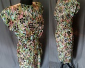 Vintage 1980s Multi-color Cocktail Dress with Metallic threading / 80s Dress with Dolman Sleeves and pee a boo back.  Size 8/10