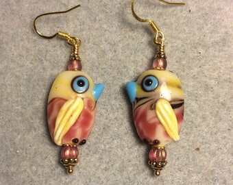 Pink, yellow and blue lampwork bird bead earrings adorned with pink Czech glass beads.