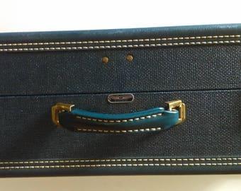 Vintage American Tourister Deep Blue Suitcase.